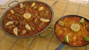 Paella Valencian and a smaller fish paella