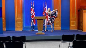 Jennifer Acuri raising the Union Flag in the new Downing Street 2.6 million pound Russian built media centre.